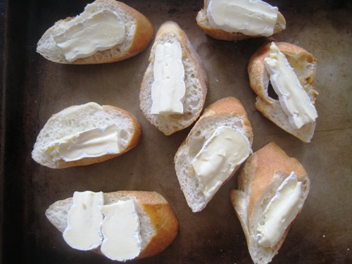 A close up of Brie toast on tray