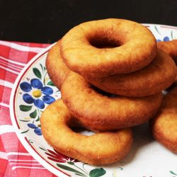 buttermilk donuts stacked on a plate