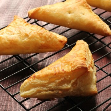 apple turnovers on a rack cooling