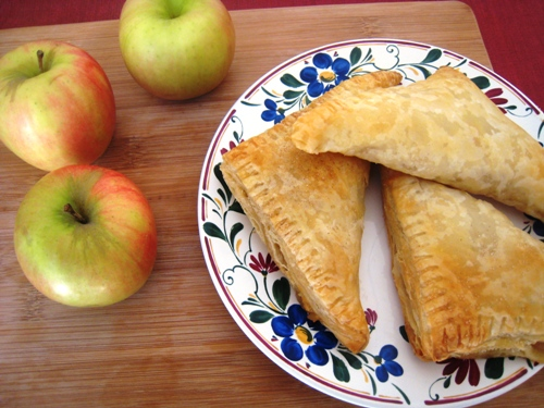 apple turnovers on plate, with apples