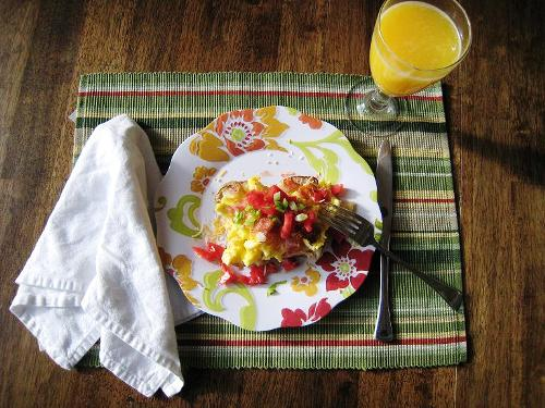 loaded breakfast potato on a plate on breakfast table