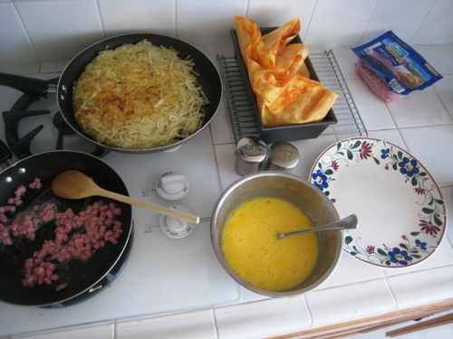 components of big breakfast on stove and counter