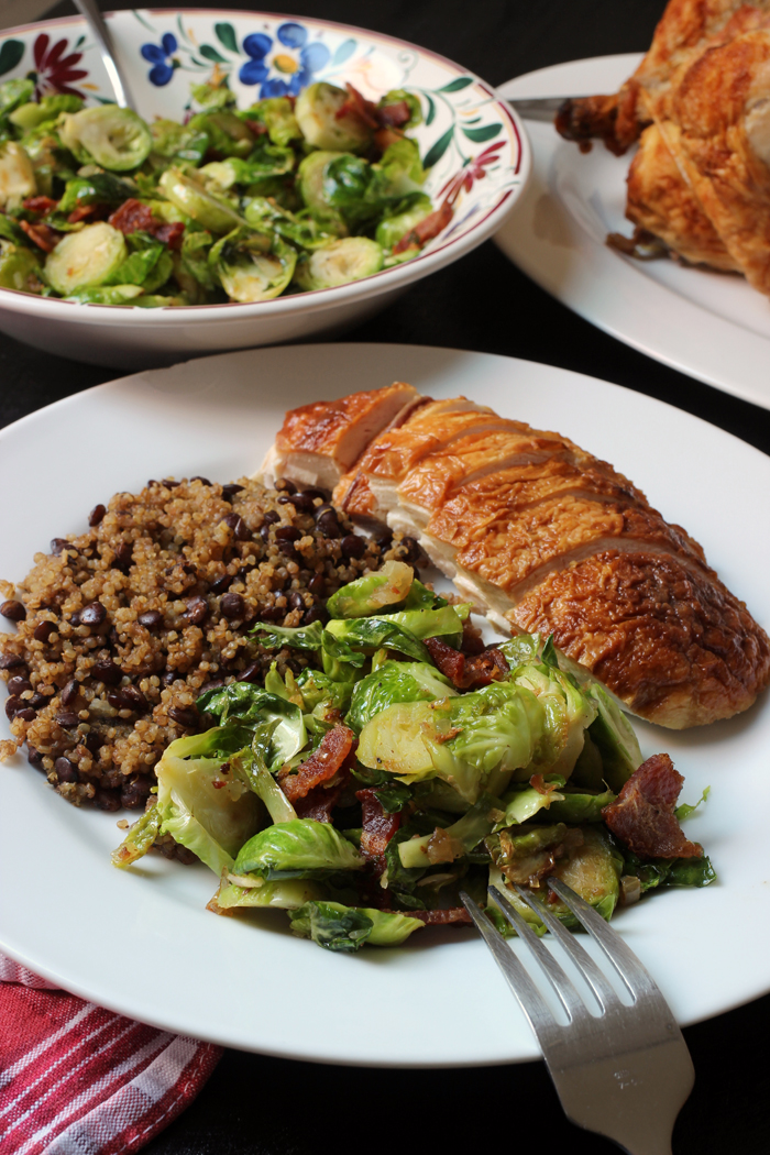 dinner plate of sprouts, quinoa, and chicken