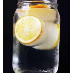A glass of water with lemon cubes