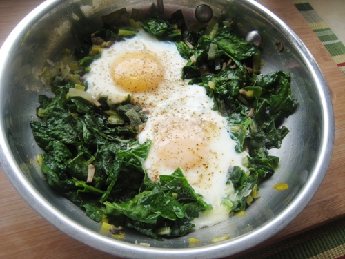 close up of Eggs and Spinach in a skillet