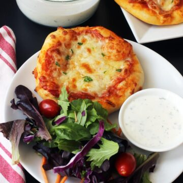 dinner plate with pizza and salad