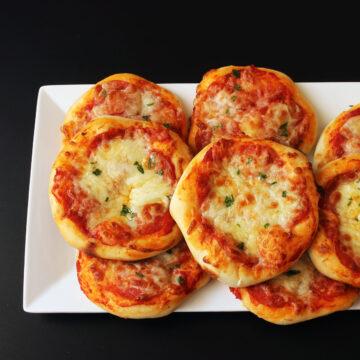 rectangular plate of mini pizzas
