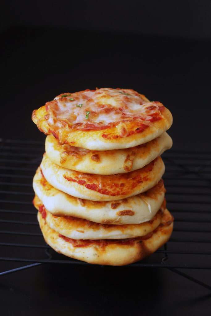 baked and cooled mini pizzas in stack