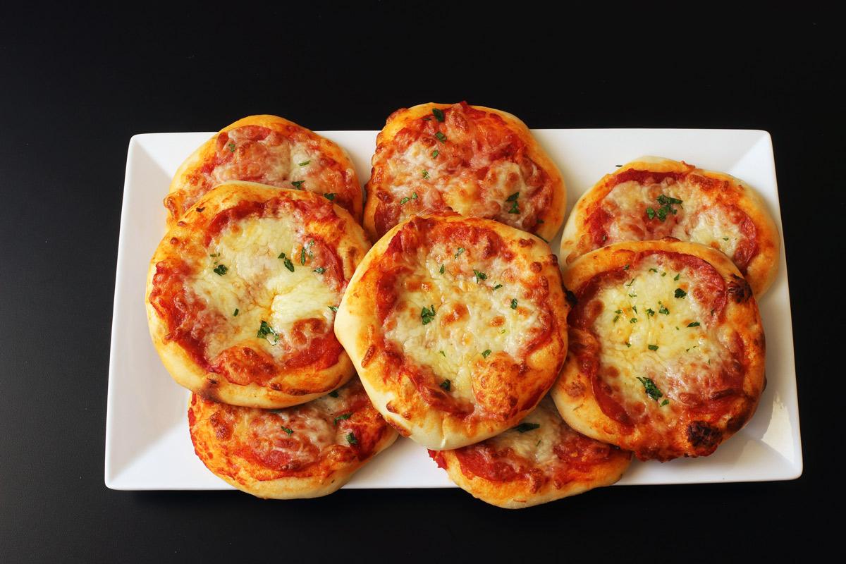 large platter of mini pizzas