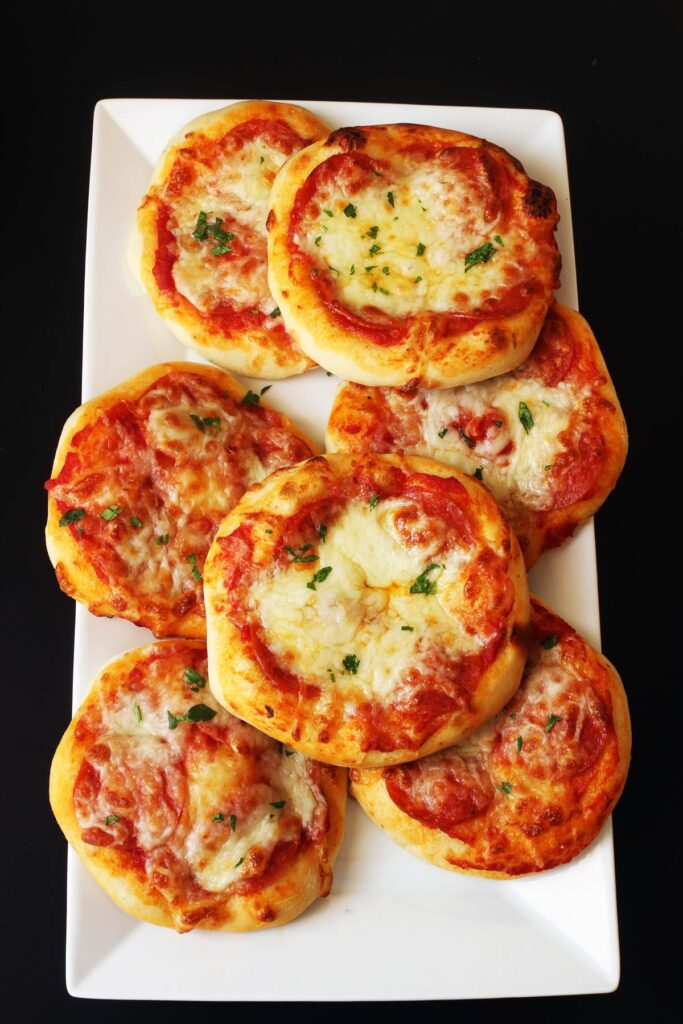 baked pizzas on platter