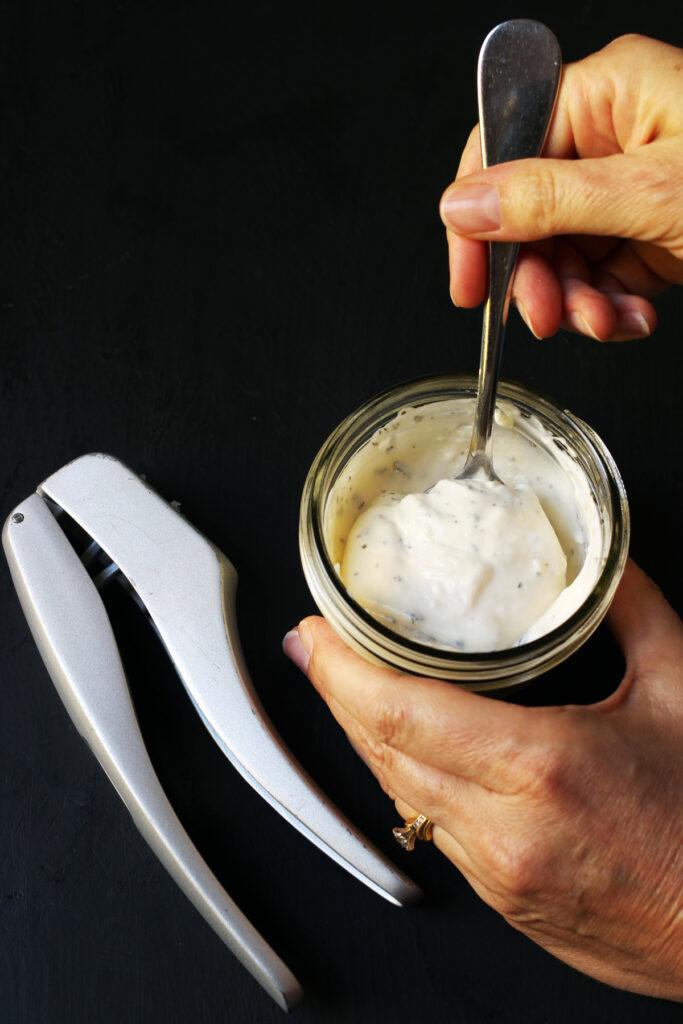 stirring sauce in jar