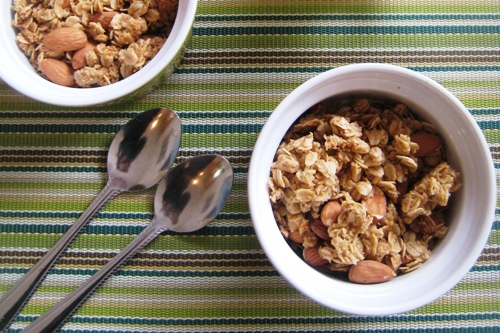 bowls of granola with spoons