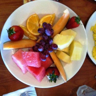 A platter of fruit at a restaurant