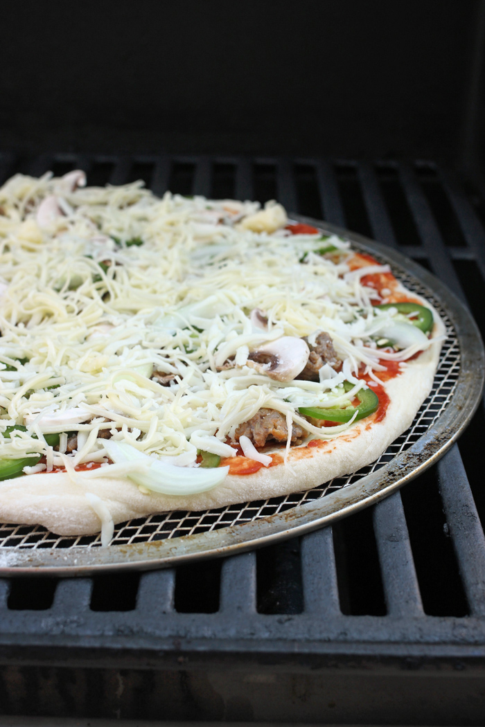 pizza on the grill uncooked