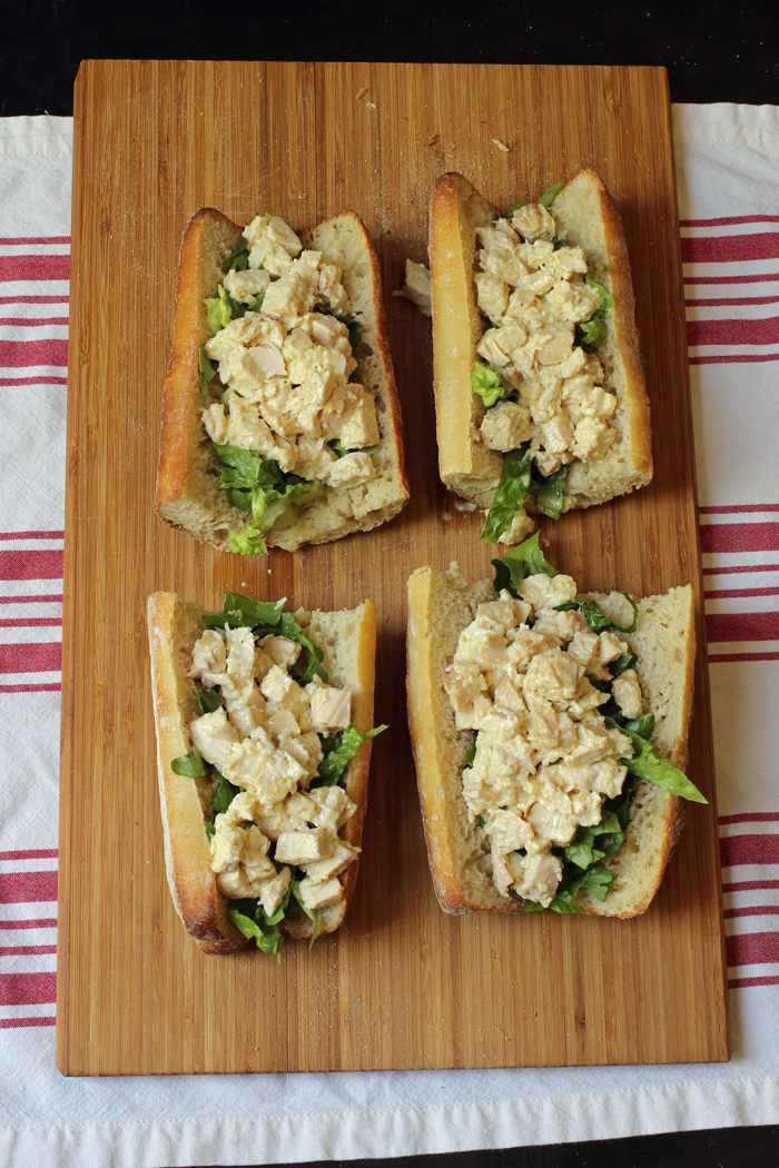 Four Chicken Caesar Baguette Sandwiches on A cutting board