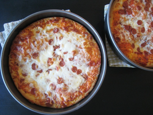 pan pizzas on table