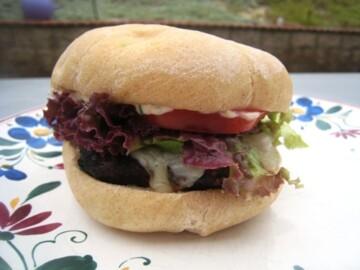 A Cilantro Chipotle Cheeseburger on a plate