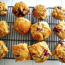 cranberry muffins cooling on a rack