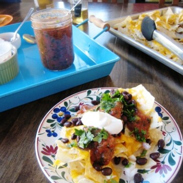 a plate of nachos on the table