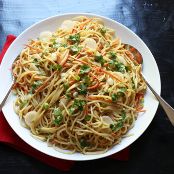 A bowl of Noodle Salad, with serving spoons
