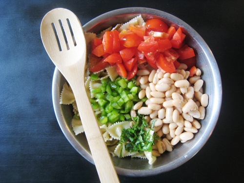 A bowl of pasta salad ingredients