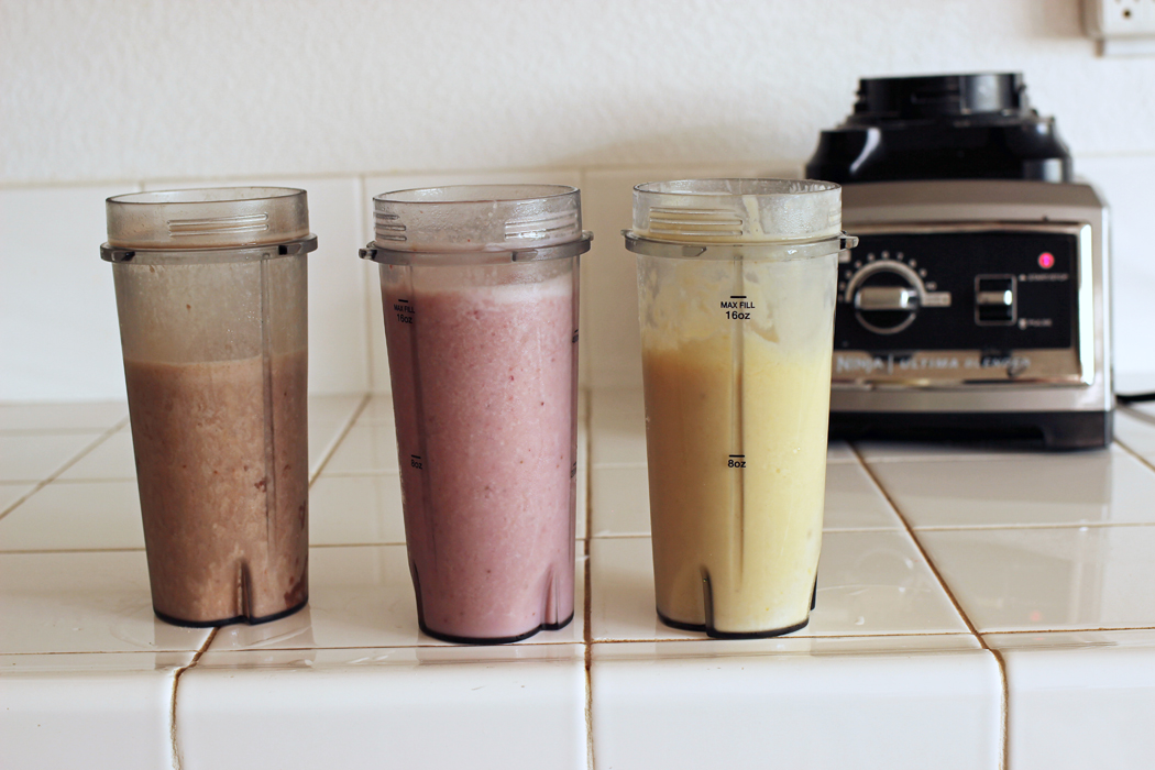 blender cups lined up on counter by high speed blender