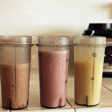blender cups with different types of smoothie