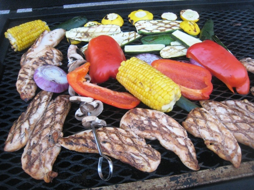 chicken and vegetables on grill