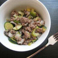 A bowl of seasoned beef and vegetables
