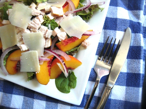 a salad plate with peaches
