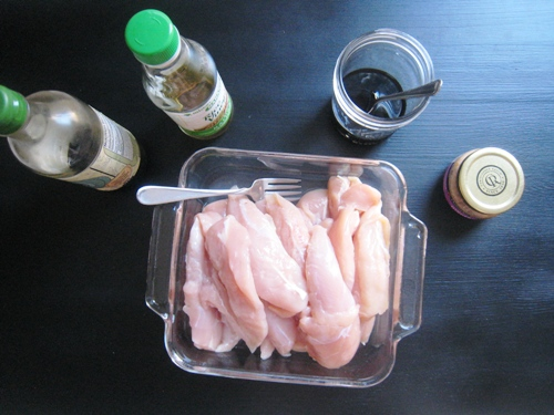 a dish of chicken tenders with marinade ingredients