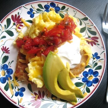 A plate of hash brown breakfast stacks, with salsa