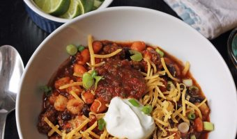 A bowl of chili on a table