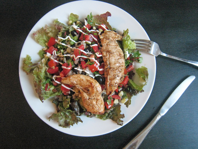 A plate of salad with Chicken and Salsa
