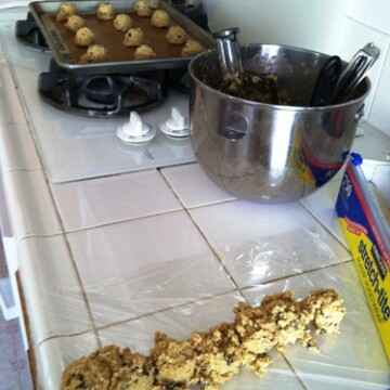 scooping out cookie dough to freeze