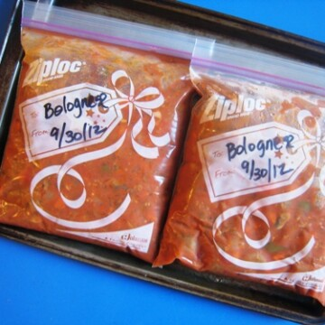freezer bags of bolognese on a tray