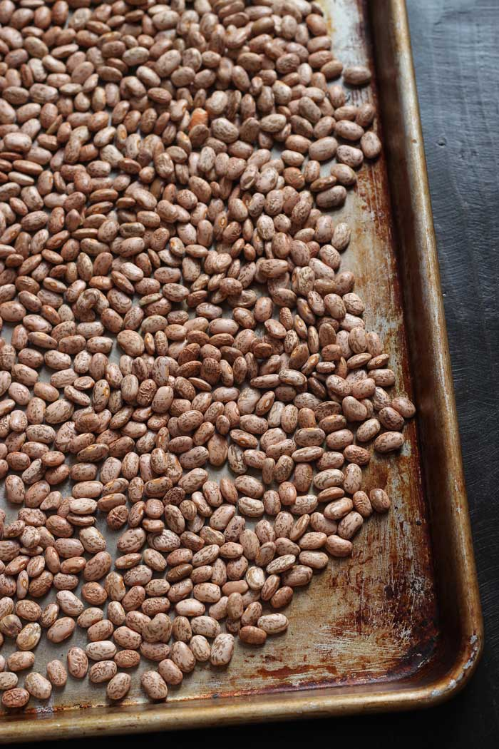 pinto beans in a metal pan for sorting
