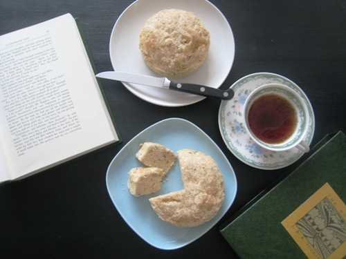 A plate of seed cakes and a cup of tea