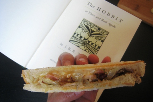 A half Bacon and Brie Panini and copy of the Hobbit book