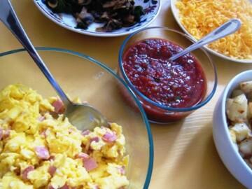 breakfast burrito bar items on a table
