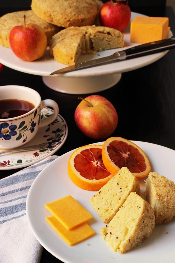 plate of treats with tea on laden tea table