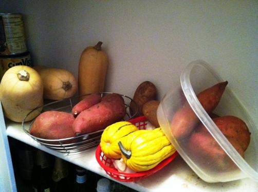 baskets of root vegetables in pantry