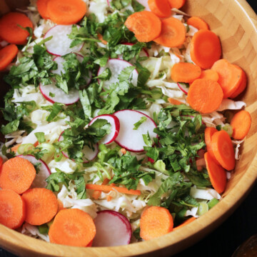 A bowl of salad, with Cabbage