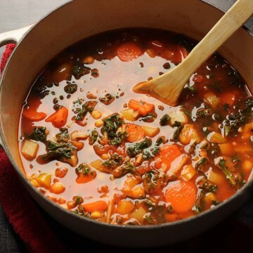 pot of minestrone with wooden spoon