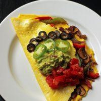 Fajita omelet on a plate on a table