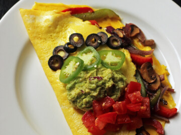 Fajita omelet on a plate on a table