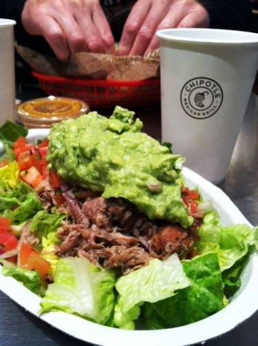 A chipotle carnitas bowl on table