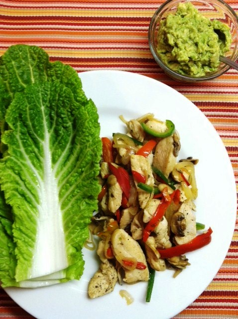A plate of fajitas and cabbage leaves