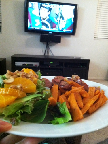 A plate of food by the TV