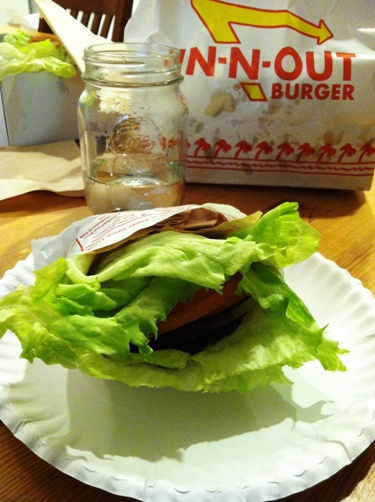 A protein burger from In-n-Out on table